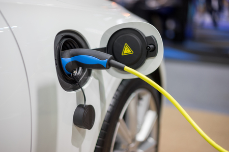 Electric car charger. Power supply electric car charging for electric car technology transportation in the future. Stock Photo