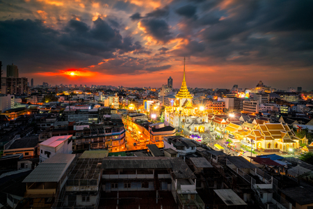 Sunset scene of Wat Traimit Withayaram Worawihan,Temple of the Golden Buddha in Bangkok, Thailand. It is one of Bangkoks most beautiful temples and a major tourist . Day to night of Wat Traimit.