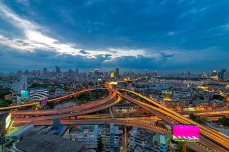 Bangkok business district  Expressway and Highway top view, Thailand at sunset