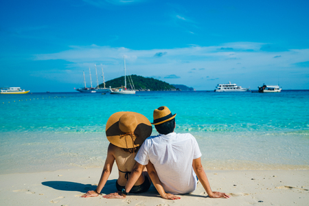 Romantic scene of young love couple sitting with relaxing and happiness on the beach in Similan islands in Andaman sea at phang nga near Krabi and Phuket in southern of Thailand. 스톡 콘텐츠