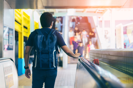 Young asian traveler walking between train station for transportation underground at Hong Kong MTR 스톡 콘텐츠