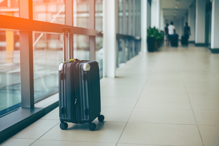 Suitcases or Baggage in airport departure lounge, summer vacation concept, traveler suitcases in airport terminal waiting area. 스톡 콘텐츠
