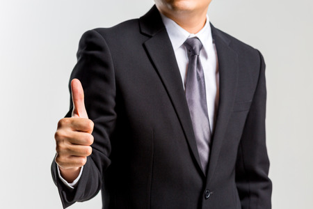 Happy businessman with suits showing thumbs up isolated on white background