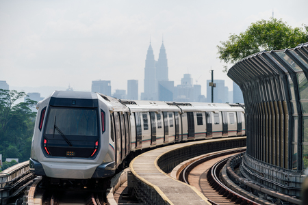 Mass Rapid Transit (MRT) train with background of cityscape in Kuala Lumpur. MRT system forming the major component of the railway system in Kuala Lumpur, Malaysia.