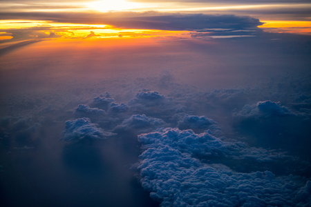 Sunrise scene above the clouds. view from the airplane, soft focus