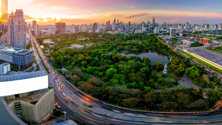 Sunset scence of Bangkok skyline Panorama ,Aerial view of modern office buildings and condominium in city downtown with sunset sky and clouds at Bangkok , Thailand. Lumpini park Editorial