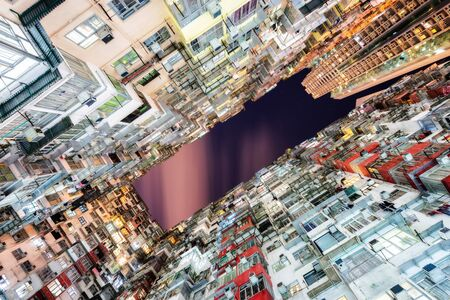 HongKong. Old tall and dense residential building in Hong Kong at dusk. 版權商用圖片