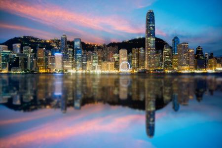 Hong Kong City skyline at sunrise. View from across Victoria Harbor Hongkong.