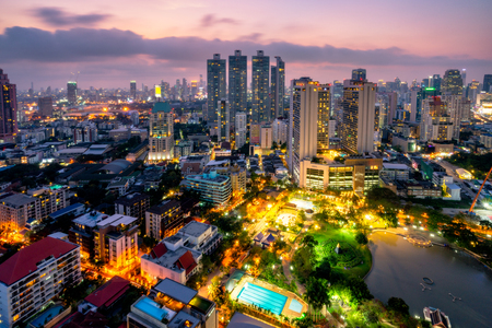 Sunset scence of Bangkok skyline Panorama and Skyscraper ,Aerial view of Bangkok modern office buildings and condominium in Bangkok city downtown with sunset sky at Benjasiri Park Bangkok Thailand. Stock Photo