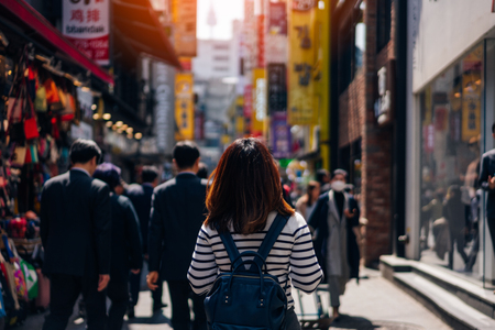 Young asian woman traveler traveling and shopping in Myeongdong street market at Seoul, South Korea. Myeong Dong district is the most popular shopping market at Seoul city. 版權商用圖片