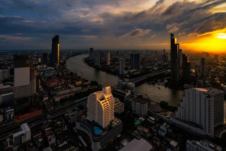 Sunset scence of Bangkok skyline Panorama and Skyscraper ,Aerial view of modern office buildings and condominium in Bangkok city downtown at Chao Phraya River Bangkok Thailand. 版權商用圖片