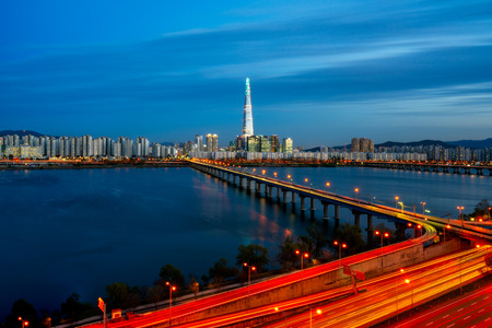 Sunset scene of Seoul downtown city skyline, Aerial view of Seoul cityscape and light trails of traffic at Han river bridge in twilight sky in sunset in Seoul city, South Korea Stock Photo