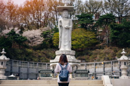 Young asian traveler traveling into Bongeunsa Temple in the Gangnam District of Seoul, South Korea. 版權商用圖片