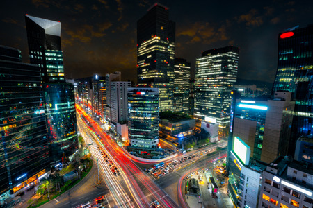 Night scene of light trails traffic speeds through an intersection in Gangnam center business district of Seoul at Seoul city, South Korea. Фото со стока