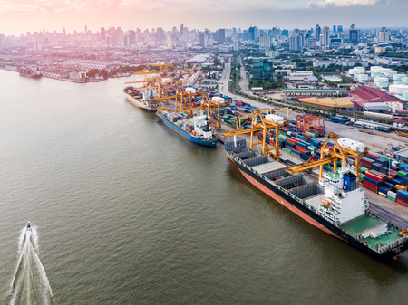 Aerial view of international port with Crane loading containers in import export business logistics. 版權商用圖片