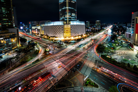 Night scene of light trails traffic speeds through an intersection in Jamsil business district of Seoul at Seoul city, South Korea.