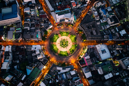 Aerial view of roundabout or circle of road with light trails on the road at night in Bangkok,Thailand. Expressway, Highway, Motorway, Tollway at Bangkok city downtown. 版權商用圖片