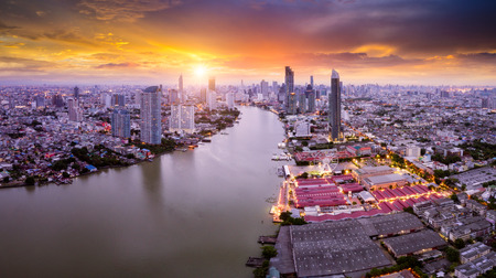 Aerial view of Bangkok skyline panorama and skyscraper in center of Bangkok city. Modern buildings condominium at Chao Phraya River Bangkok Thailand at sunrise.