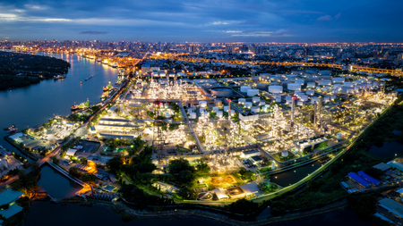 Aerial view of oil refinery near international port at night. Panorama of refinery plant at night. refinery factory and tank