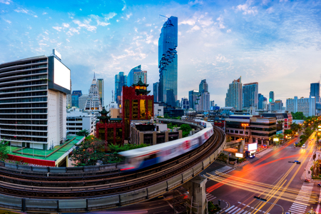 Aerial view of Bangkok modern office buildings and condominium in Bangkok city downtown with blue sky and clouds at Bangkok, Thailand. BTS skytrain