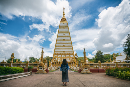 Young woman traveler traveling into Wat Phra That Nong Bua is a Dhammyuttika temple, one of important temples in Ubon Ratchathani Thailand.