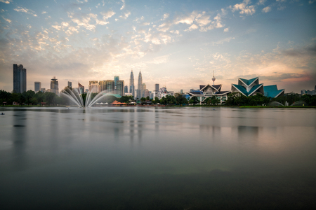 Cityscape of Kuala Lumpur Panorama at sunset. Panoramic image of skyscraper at Kuala Lumpur, Malaysia skyline with blue sky and cloud. Stockfoto