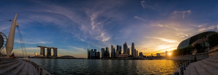 Panorama of the Singapore landmark financial district at twilight sunset scene with blue sky and clouds. Singapore downtown Redactioneel