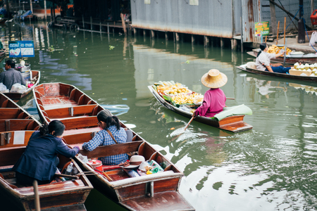 Damnoen Saduak floating market is the most famous traditional floating market in Thailand at Damnoen Saduak district in Ratchaburi province near Bangkok Thailand