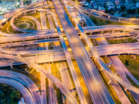 Top view of Highway road junctions at night. The Intersecting freeway road overpass the eastern outer ring road of Bangkok, Thailand. Stockfoto - 110824836