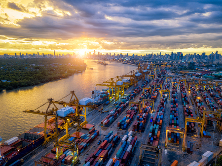 Aerial view of international port with Crane loading containers in import export business logistics with cityscape of Bangkok city Thailand at sunset Stockfoto - 110824840
