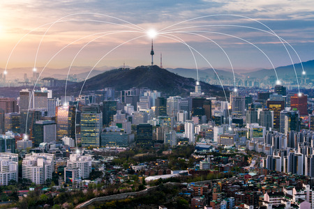 Seoul downtown city skyline with network connection concept, Aerial view of N Seoul Tower at Namsan Park in twilight sky in morning. The best viewpoint from inwangsan mountain in Seoul, South Korea