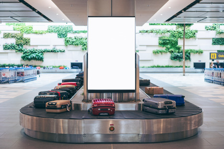 Blank advertising billboard with baggage and luggage in the international airport Stockfoto - 110824852