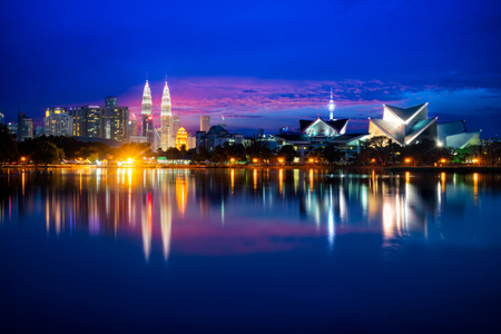 Cityscape of Kuala Lumpur Panorama at twilight. Panoramic image of Titiwangsa park at Kuala Lumpur, Malaysia skyline during sunset. Stockfoto - 110805724