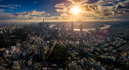 Aerial view of Ho Chi Minh City skyline and skyscrapers in center of heart business at Ho Chi Minh City downtown. Panorama of cityscape on Saigon river in Ho Chi Minh City at Vietnam at sunrise scene Stockfoto - 110824862
