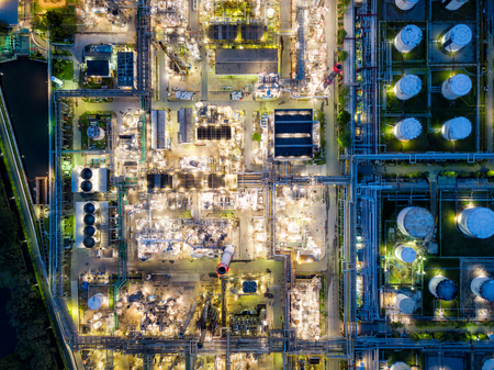 Top view of oil refinery at night. Aerial view of refinery plant at sunset. refinery factory and tank