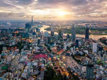Aerial view of Ho Chi Minh City skyline and skyscrapers in center of heart business at Ho Chi Minh City downtown. Panorama of cityscape on Saigon river in Ho Chi Minh City at Vietnam at sunrise scene