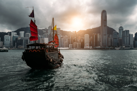 Hong Kong City skyline with tourist sailboat. View from across Victoria Harbor Hong Kong. Редакционное