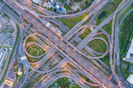 Top view of Highway road junctions. The Intersection freeway road overpass the western outer ring road of Bangkok, Thailand.