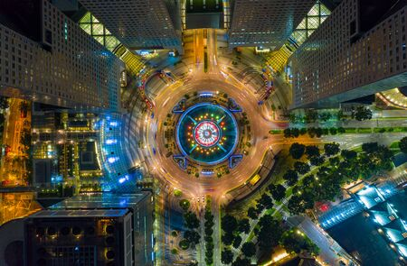 Top view of the Singapore landmark financial business district with skyscraper. Fountain of Wealth at Suntec city in Singapore at night 写真素材