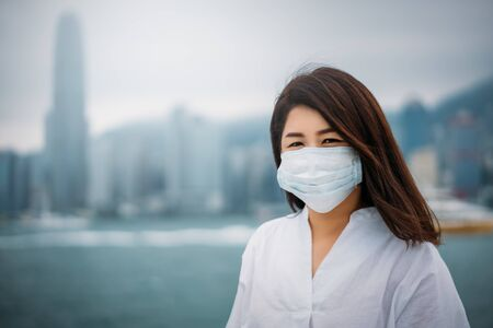 Young asian woman wearing protective face mask