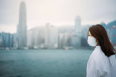 Young asian woman wearing protective face mask Stock fotó - 145142268
