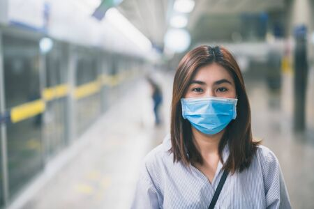 Young asian woman wearing protective face mask in subway due to the polluted air or pm 2.5 and Coronavirus disease or COVID-19 outbreak situation in all of landmass in the world. Stock fotó - 145235664
