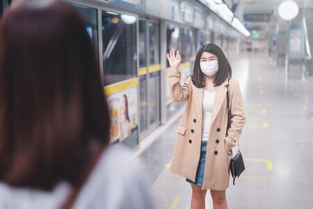 Two young asian women friends wearing protective mask meet in a subway station with bare hands. Instead of greeting with a hug or handshake due to Coronavirus disease or COVID-19 outbreak situation Stock fotó - 147260675