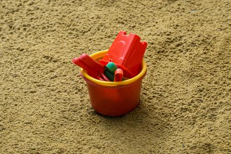 Sandblast toys in Sand Background