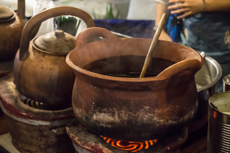 Vintage Clay Pot making Thai Curry in Street market Stock Photo