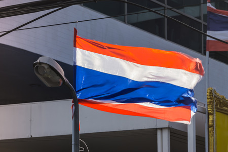 THAILAND Nation Flag blown by the wind in Sunny day Evening Flag Nation Concept.