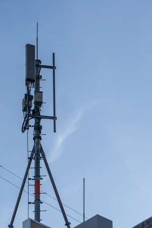 Mobile Network Antenna with blue Sky in Communication Concept.