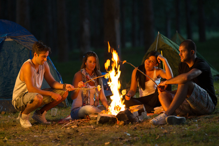 forest fire: Friends camping  Selected focus on Stock Photo