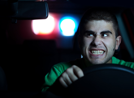 Police in pursuit of a man in the car. Selected focus on face photo