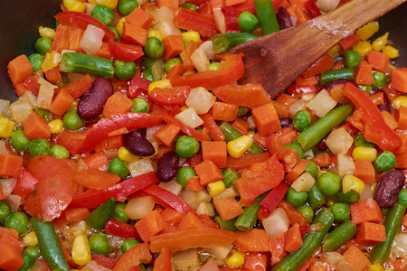 A mixture of vegetables frying in a pan Stock Photo